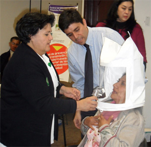 Dr. Lauzardo instructing a participant on how to perform a fit test